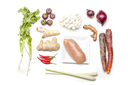 ingredients of a thai tom kha gai soup on white