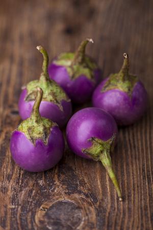 asian eggplant on dark wood