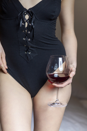 closeup of a woman in underwear with red wine  Stock Photo