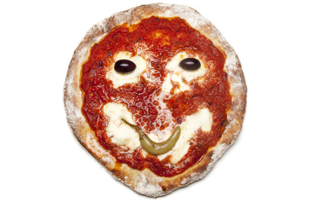 smiley on a backed pizza  Stock Photo