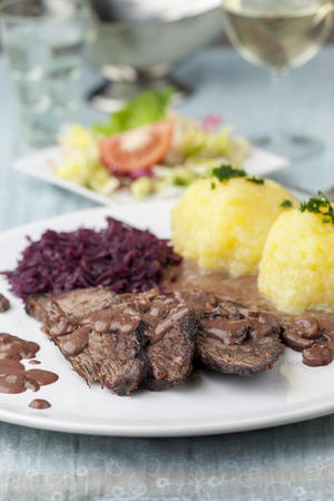 german sauerbraten with red cabbage on a plate  Stock Photo