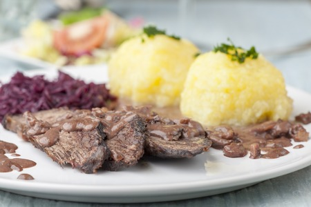 german sauerbraten with red cabbage on a plate  Banque d'images