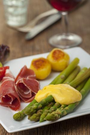 green asparagus with sauce hollandaise on a plate  Stock Photo