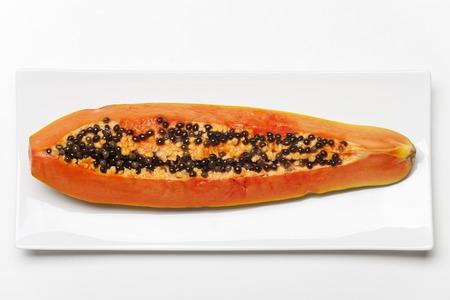 slice of a ripe papaya on a plate