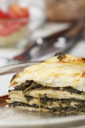 spinach lasagna on a glass plate  Stock Photo