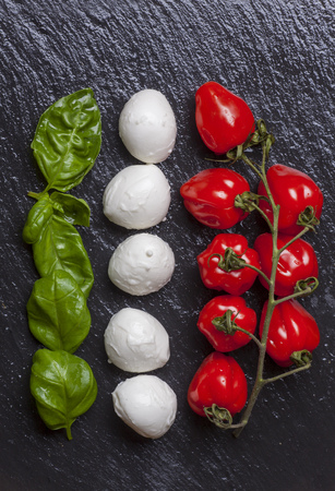 ingredients of insalada caprese on black slate  Stock Photo