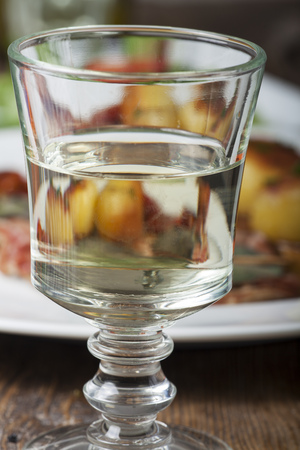 white wine in a glass an saltimbocca