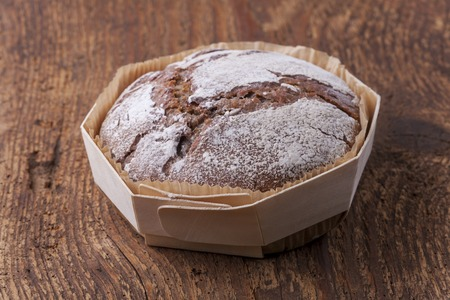 whole rye bread on dark wood