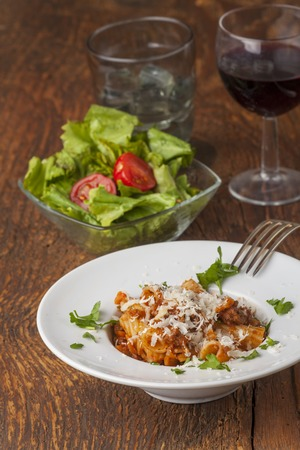 rigatoni pasta with sauce bolognaise and cheese  Stock Photo
