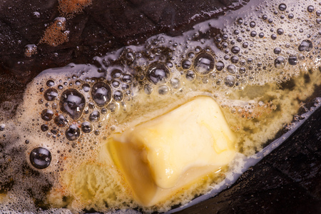 butter melting in a pan