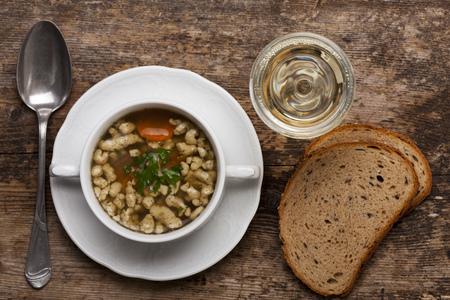 bavarian bratnockerl soup in a cup  Reklamní fotografie
