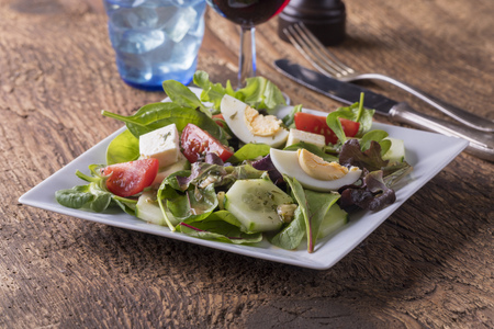 salad with feta and eggs and red wine Stock Photo
