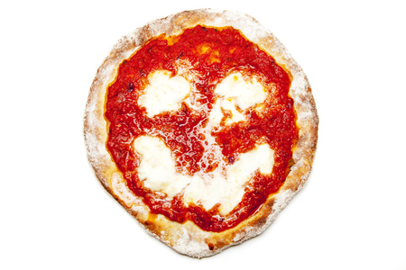 smiley on a backed pizza