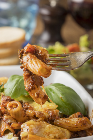 fork with rigatoni al ragu with cheese