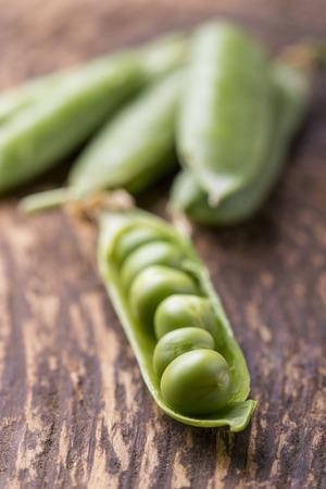 closeup of an open raw pea