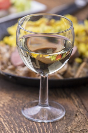 white wine and swabian pork filet with spaetzle on wood Stock Photo