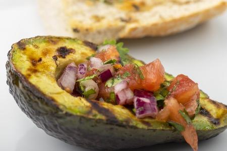 grilled avocado with tomato salsa Stock Photo