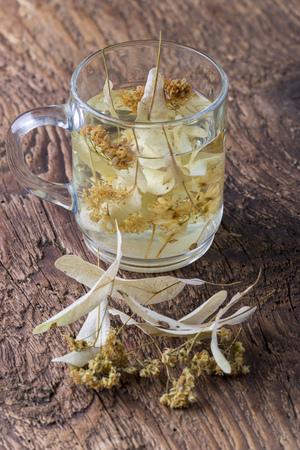 linden flower tea on wood Stock Photo