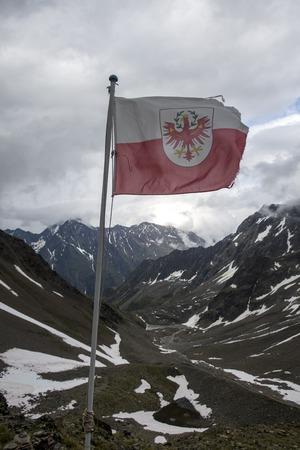 tyrolean flag in the austrian alps Stock Photo