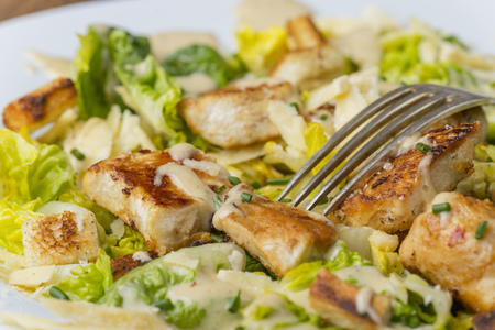 overview of a cesar salad on a plate