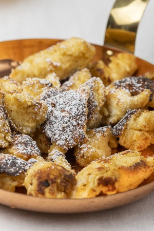 austrian kaiserschmarrn on dark wood