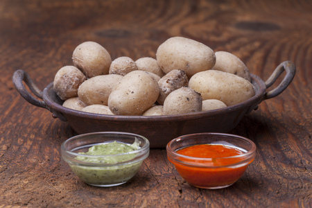 typical potatos from canary islands with mojo Stock Photo