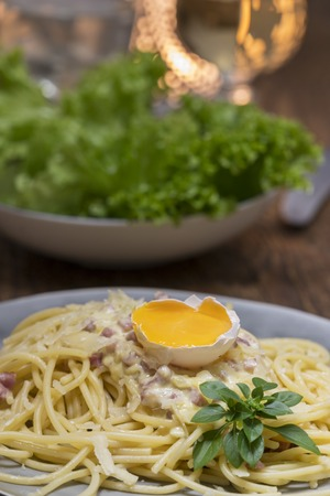 spaghetti carbonara on a white plate Stock Photo