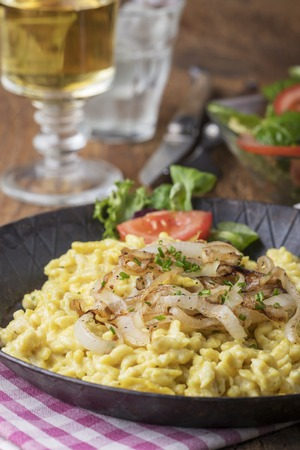 closeup of bavarian kaes spaetzle on wood