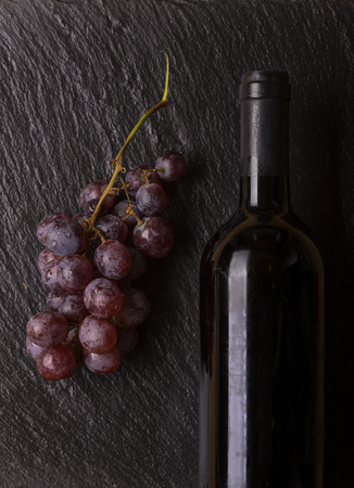 bottle of wine with grapes Stock Photo