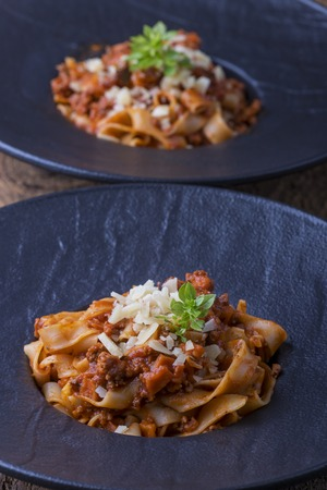 tagliatelle with sauce bolognaise and parmigiano  Stock Photo