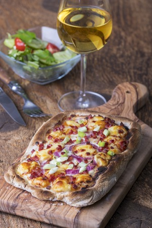 home made french flammkuchen with wine
