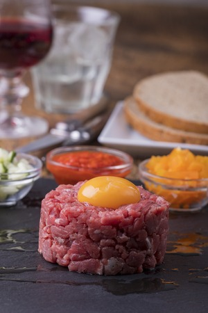 steak tartare with an egg on slate