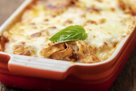 closeup of home made lasagna on wood