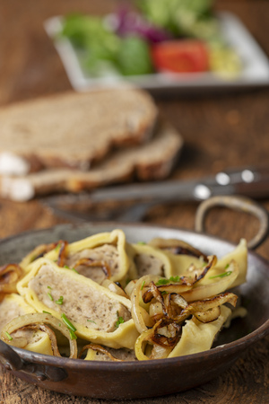 swabian maultasche with onions in a pan