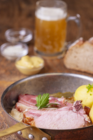 closeup of a french choucroute dish on wood Stock Photo