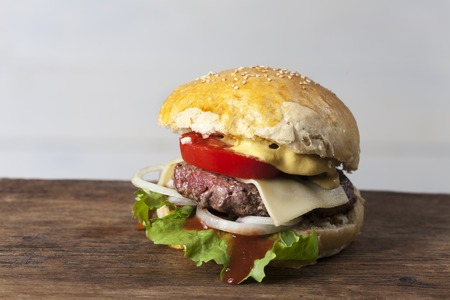 home made hamburger on rustic wood Stock Photo