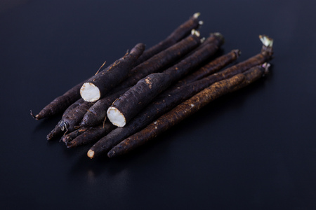 salsify roots on a board Stock Photo