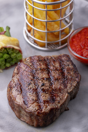 closeup of grilled steak with french fries Stock Photo