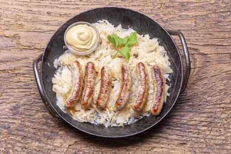 grilled nuremberger bratwurst with sauerkraut