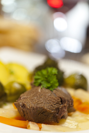tafelspitz meat on a plate with vegetables