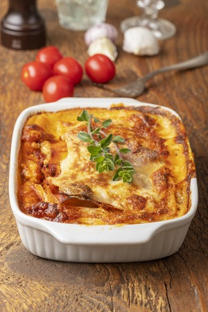 overview of a cooked lasagna on wood
