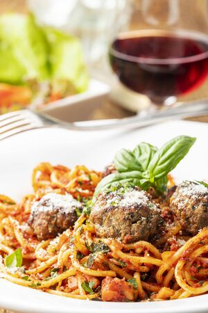 spaghetti with meat balls on dark wood Stock Photo