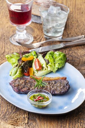 grilled steak a plate with salad Фото со стока
