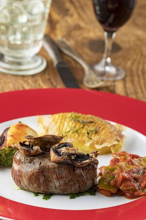 grilled steak on a plate with wine Фото со стока