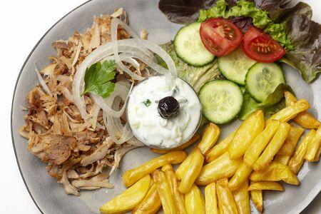 greek gyros with tzaziki and fries Фото со стока - 130131127