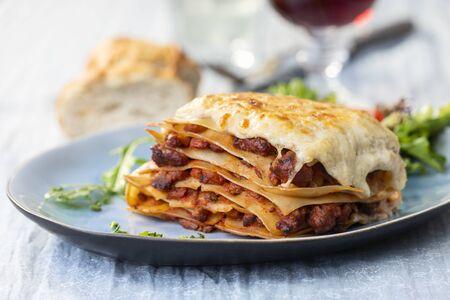portion of lasagna with wine Фото со стока