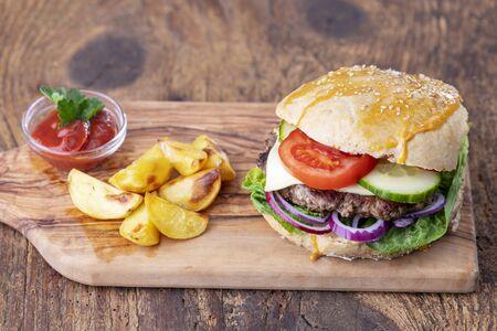home made burger on dark wood