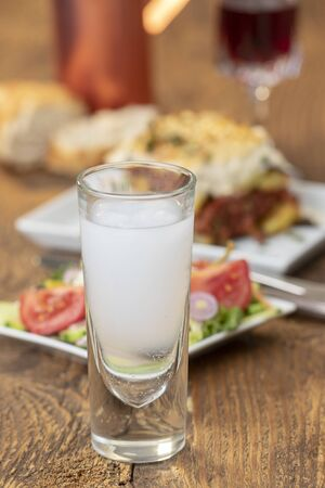 greek ouzo with moussaka on wood