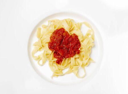 italian tagliatella pasta with tomato sauce Фото со стока