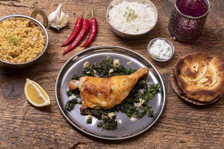 indian spinach chicken on dark wood